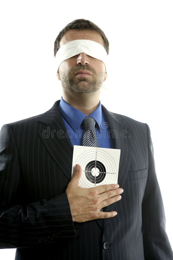 Blindfolded businessman with target over white royalty free stock photography