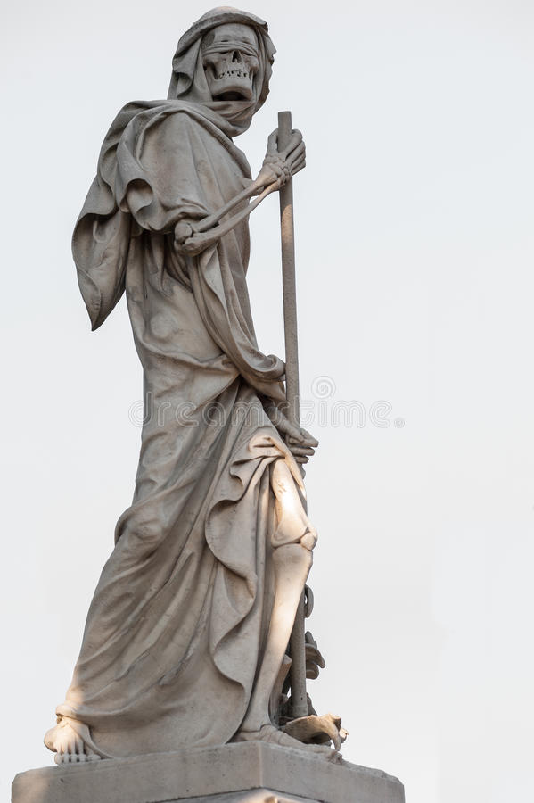 The blindfolded Grim Reaper Death personified statue. The grim reaper skeleton on white background royalty free stock photo