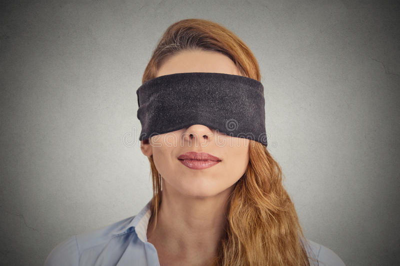 Blindfolded red haired woman stock image