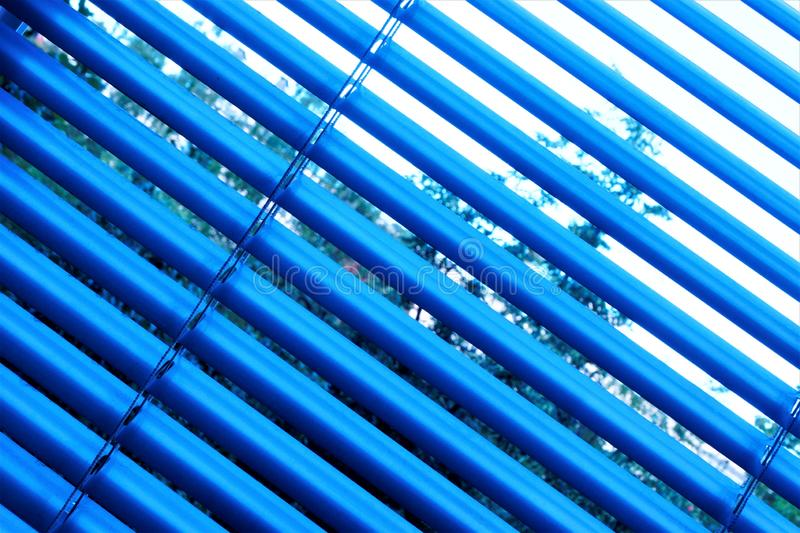 Blinds are effective light protection devices made of vertical or horizontal slats. Slats can be fixed or rotated to regulate. Light and air flow. Blinds are stock images