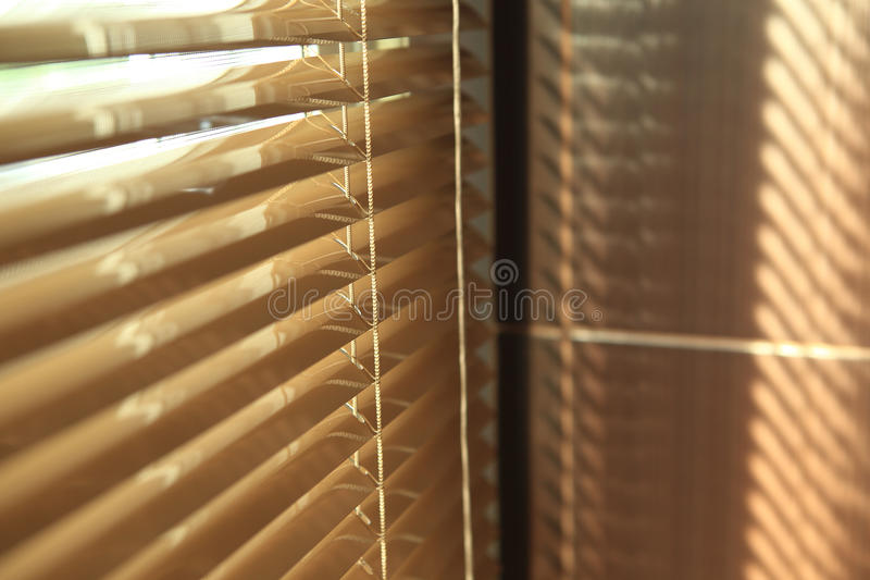 Blinds in home with sunlight royalty free stock images