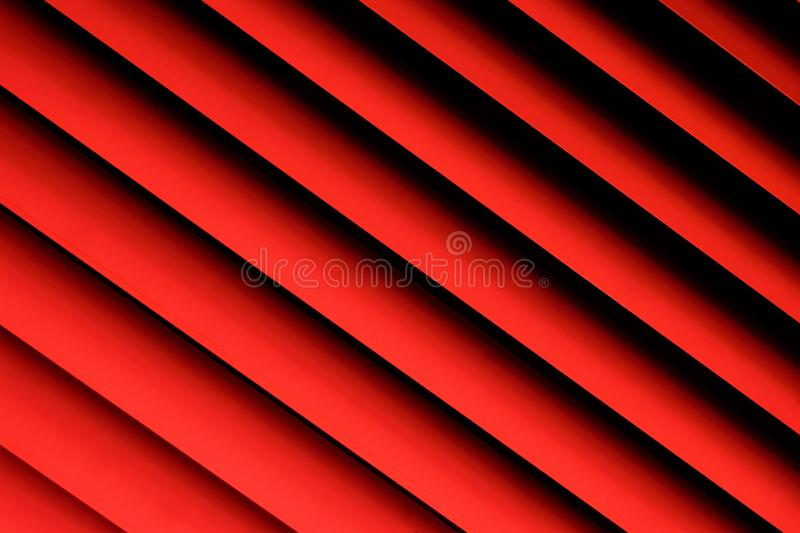 Blinds pink background—effective light protection devices from horizontal slats. Slats can be fixed or rotated, regulate light. And air flow. Blinds are stock images