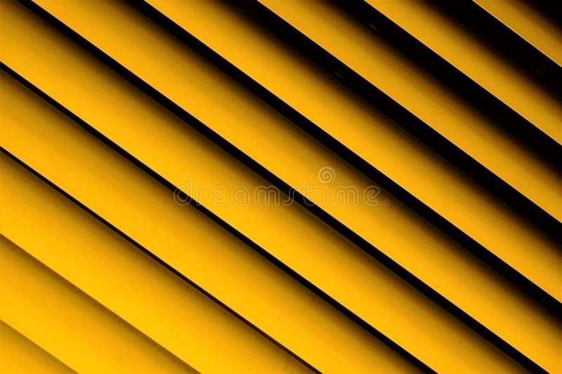 Blinds yellow background—effective light protection devices from horizontal slats. Lamellas are stationary, turn, regulate light. Air flow. Blinds are royalty free stock image