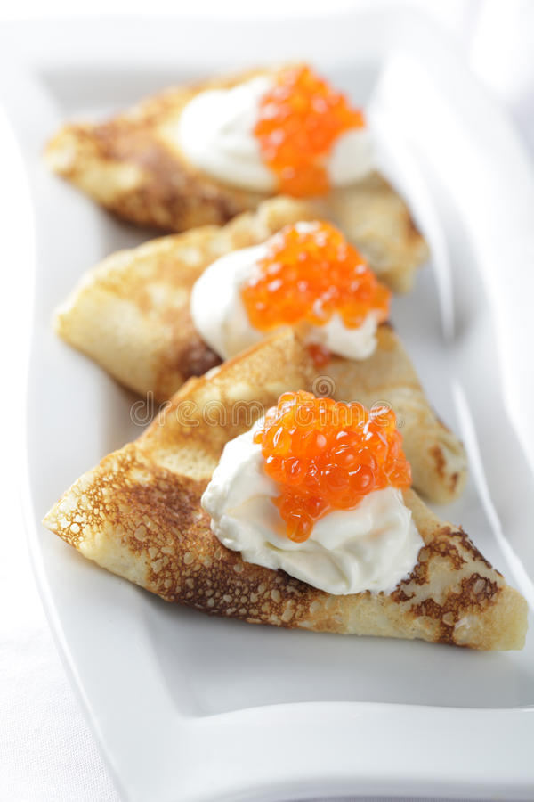 Blinis with red caviar royalty free stock photography