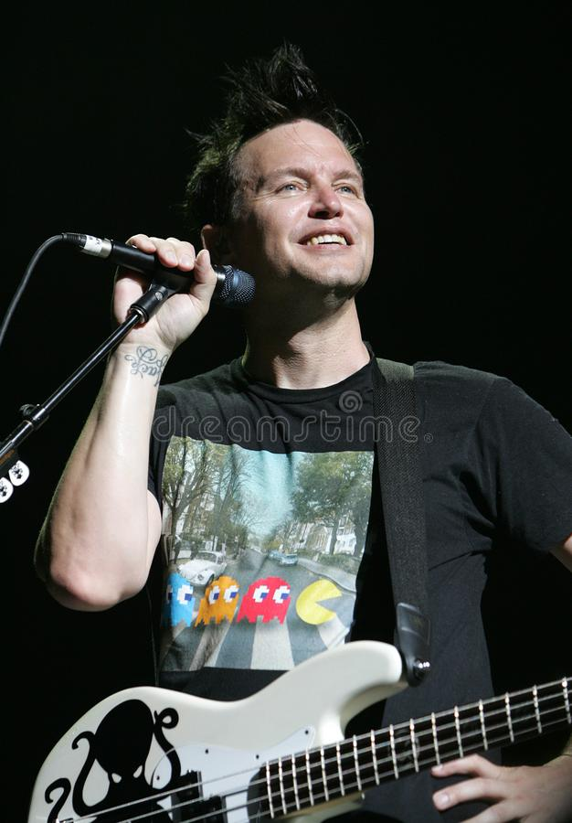 Blink 182 performs in concert. Mark Hoppus with Blink 182 performs in concert on the Honda Civic Tour at the Cruzan Amphitheater in West Palm Beach, Florida on stock photography