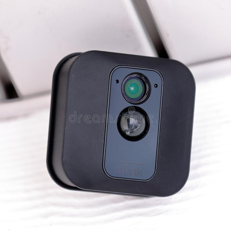Blink XT Outdoor security camera. Closeup view of Blink XT Outdoor wireless security camera under a roof watching for intruders royalty free stock photo