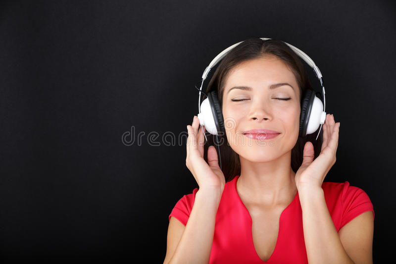Download Blissful Beautiful Woman Listening To Music Stock Photo - Image of earphones, brunette: 39501174