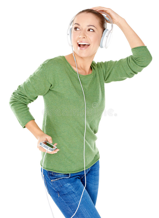 Blissful woman dancing and listening to music stock images