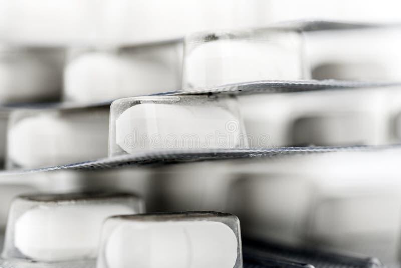 Blister packs of white pills. Shallow DOF stock photo