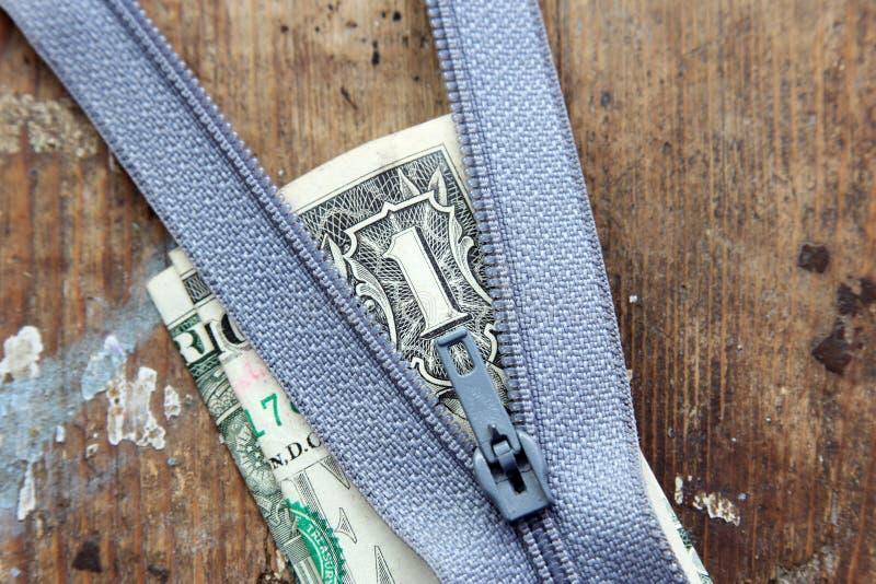 Blixtlås med pengar royaltyfri fotografi