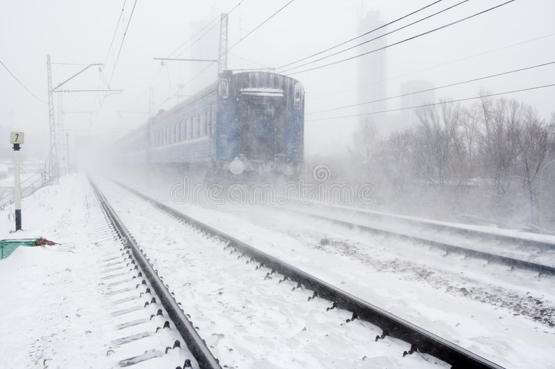Blizzard and passing train royalty free stock photo