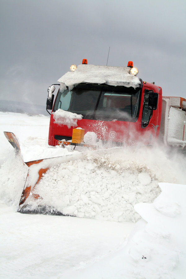 Blizzard snowplough. Snowplough clear snow in blizzard. Snow storm hit Denmark and truck stuggle to scrape road stock photography