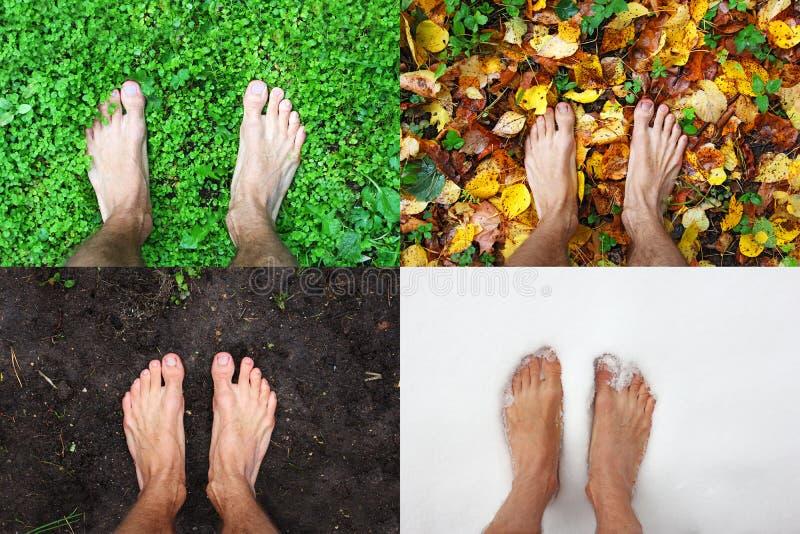 Bloße Mannvierjahreszeitenfüße steht Sommer auf grünem Gras, Winterschnee, Herbstlaub, Frühlingsboden, Draufsicht, Kopienraum lizenzfreie stockfotografie