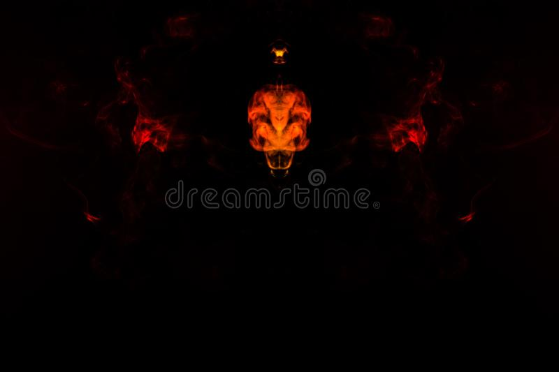 A blob of red and orange smoke in the form of a wavy pattern in the center of the frame depicting the head of a monster or an royalty free stock photos