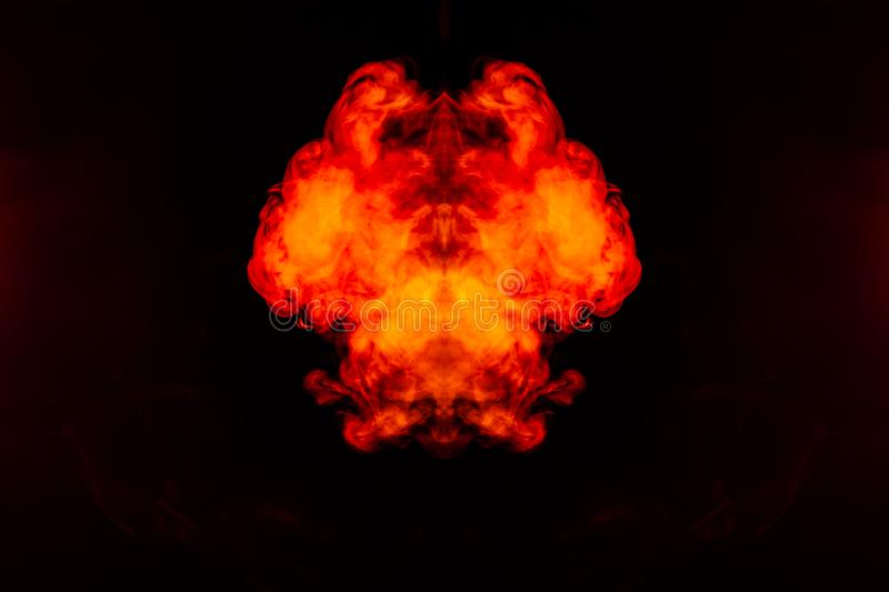 A blob of red and orange smoke in the form of a wavy pattern in the center of the frame depicting the head of a monster or an. Animal with eyes, not like a royalty free stock images