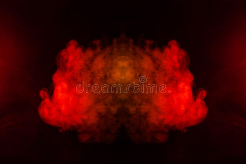 A blob of red and orange smoke in the form of a wavy pattern in the center of the frame depicting the head of a monster or an. Animal with eyes, not like a stock image