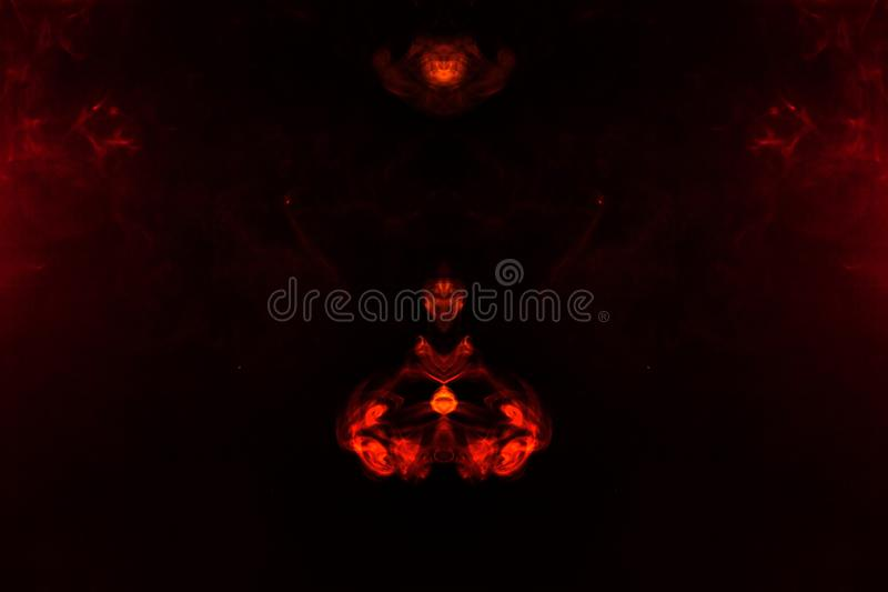 A blob of red and orange smoke in the form of a wavy pattern in the center of the frame depicting the head of a monster or an. Animal with eyes, not like a royalty free stock photos
