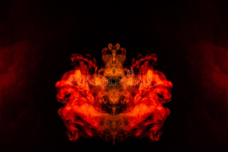 A blob of red and orange smoke in the form of a wavy pattern in the center of the frame depicting the head of a monster or an. Animal with eyes, not like a stock photography