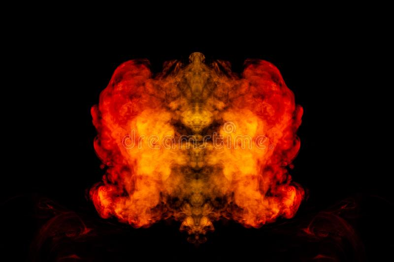A blob of red and orange smoke in the form of a wavy pattern in the center of the frame depicting the head of a monster or an. Animal with eyes, not like a royalty free stock photography