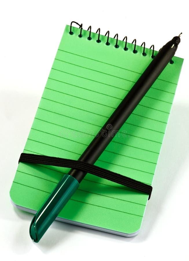Bloc-notes et stylo images libres de droits