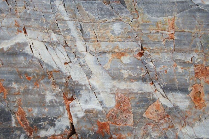 Blocchetto di marmo antico stagionato Cracked Priorità bassa di pietra strutturata immagini stock libere da diritti