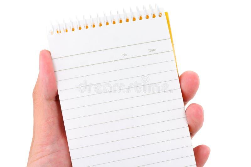 Blocchetto per appunti della holding della mano immagini stock