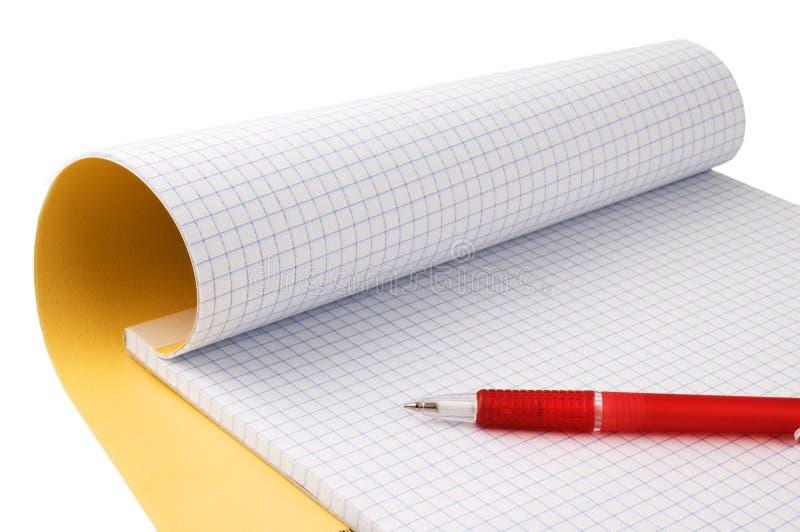 Blocchetto per appunti e penna fotografie stock