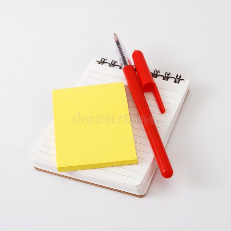 Blocchetto per appunti ed appunto fotografia stock libera da diritti