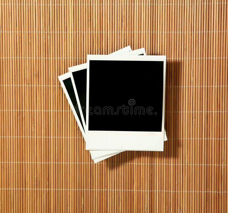 Blocchi per grafici in bianco del Polaroid dell'annata fotografia stock libera da diritti
