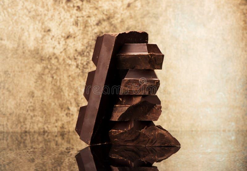 Blocco e cioccolato dei pezzi fotografia stock libera da diritti