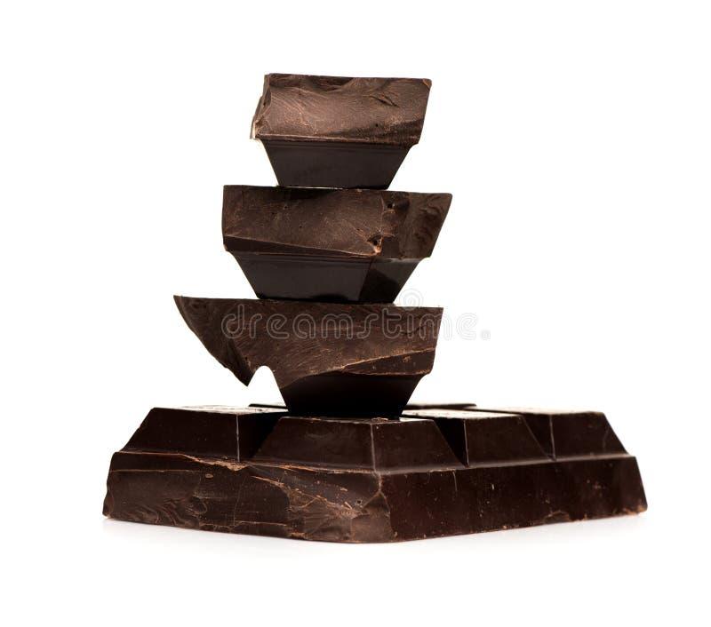 Blocco e cioccolato dei pezzi immagine stock libera da diritti