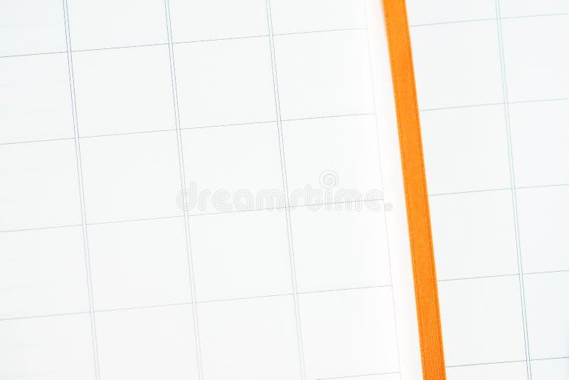 Blocco note con l'impianto a scacchiera del blocco immagine stock libera da diritti