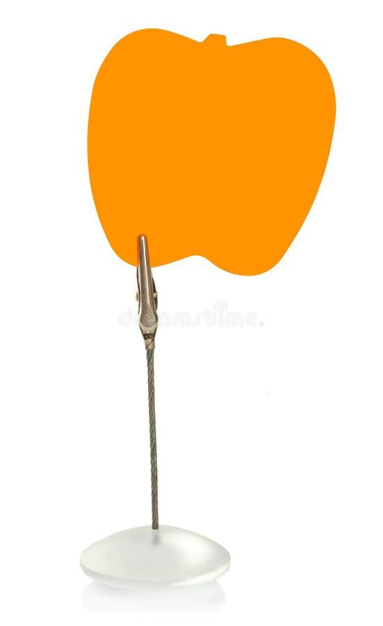 Blocco note a forma di mela su supporto con la molletta da bucato fotografie stock