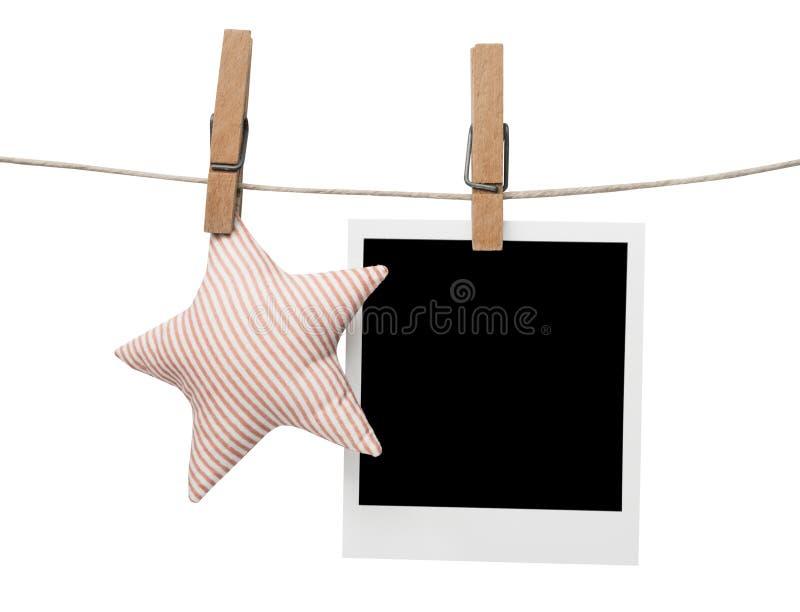 Blocco per grafici in bianco della foto della polaroid con la stella fotografie stock libere da diritti