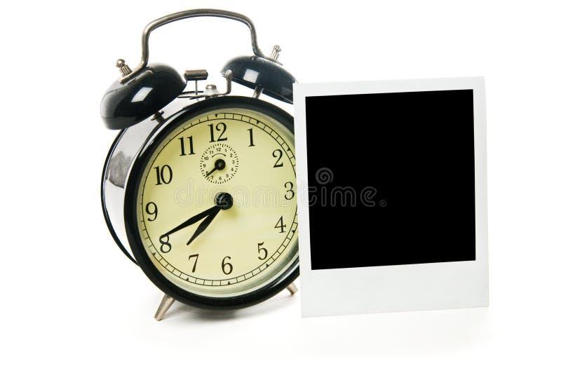 Blocco per grafici del polaroid e della sveglia fotografie stock libere da diritti
