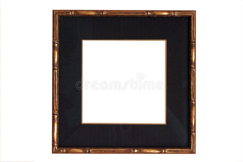 Blocco per grafici di legno dell'oro con la stuoia nera immagine stock