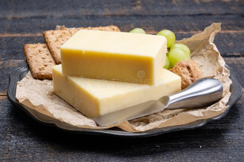 Block of aged cheddar cheese, the most popular type of cheese in royalty free stock photography