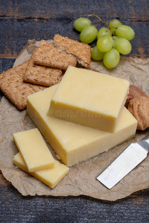 Block of aged cheddar cheese, the most popular type of cheese in stock images