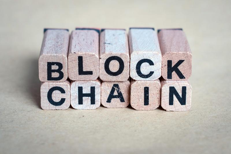 Block chain concept - letters on wooden blocks stock photos