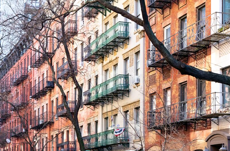 Block of colorful old buildings in the Upper East Side neighborhood of Manhattan in New York City stock images