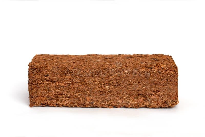 Block der Kokosnuss-Coir-Hülse-Faser lokalisiert auf weißem Hintergrund stockbild