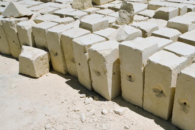 Marsaxlokk, Malta, August 2019. Yellow stone bricks as cargo for fishing nets. Block.The famous Maltese limestone, soft during mining and quickly hardening in stock image
