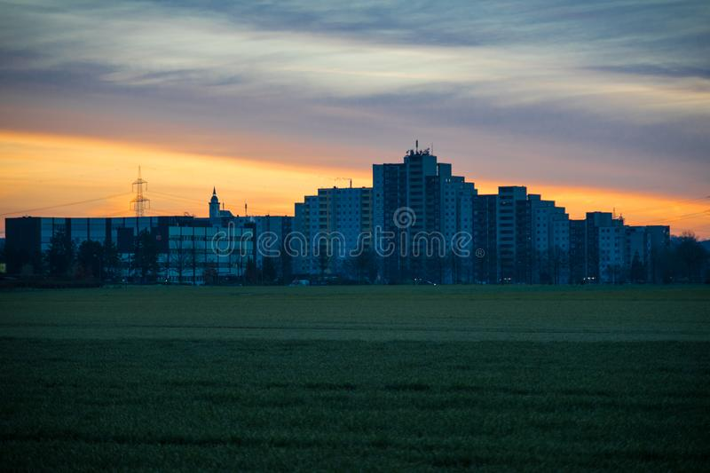 Block of flats in the early morning light. The sun rises behind the building royalty free stock photos