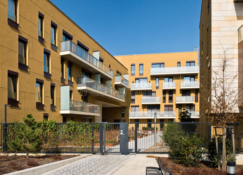 Block of flats with security fence. Newly built block of flats with security fence stock photo