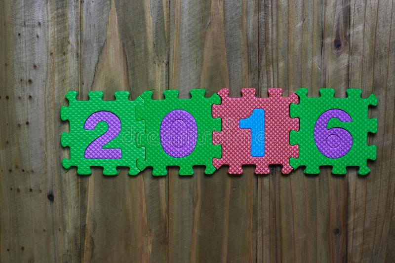 Download Block Letters And Numbers 2016 With Wood Background Stock Image - Image of puzzle, word: 63113901