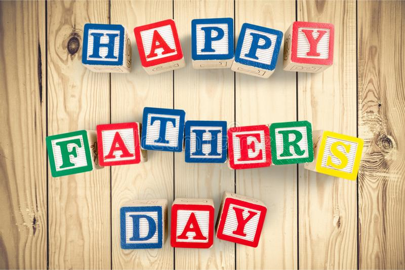 Block letters spelling happy fathers day royalty free stock image