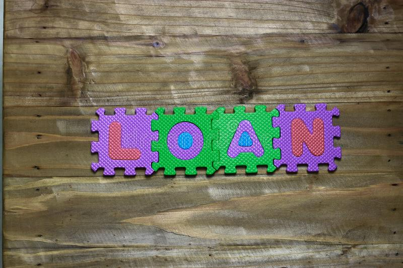 Block letters and word loan with wood background royalty free stock image