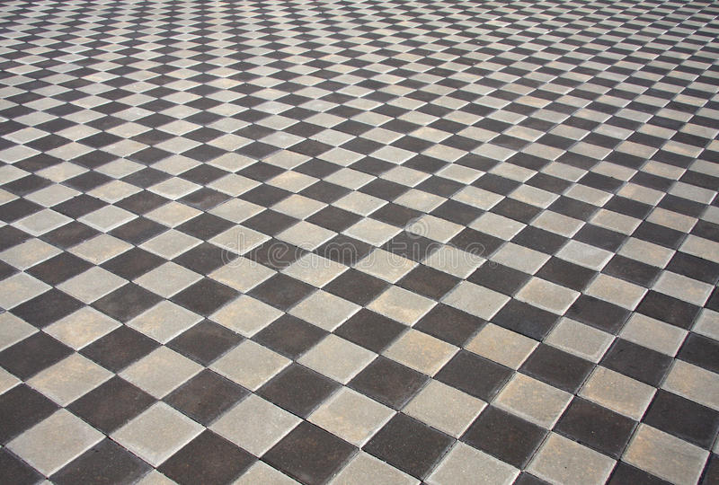 Block pavement background. Grey block pavement in the city stock images
