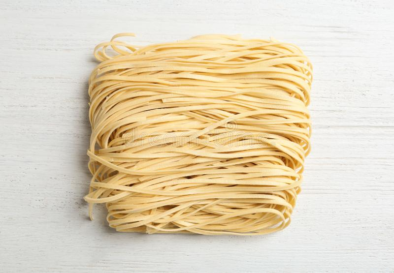 Block of quick cooking noodles on wooden background, royalty free stock images