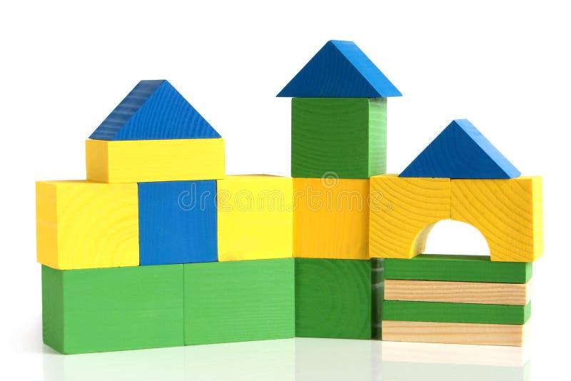 block som bygger barnhuset, gjorde s trä royaltyfri foto